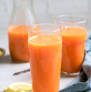 Detox with this immunity boosting carrot orange juice that can be made in a juicer or a blender! Learn how to make this easy and healthy recipe today!